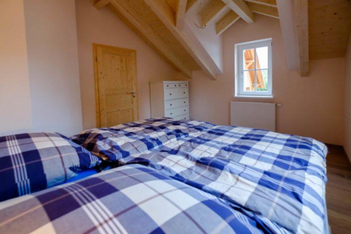 Ferienhaus / Ferienwohnung Schlafzimmer 1 mit Doppelbett im ersten Stock